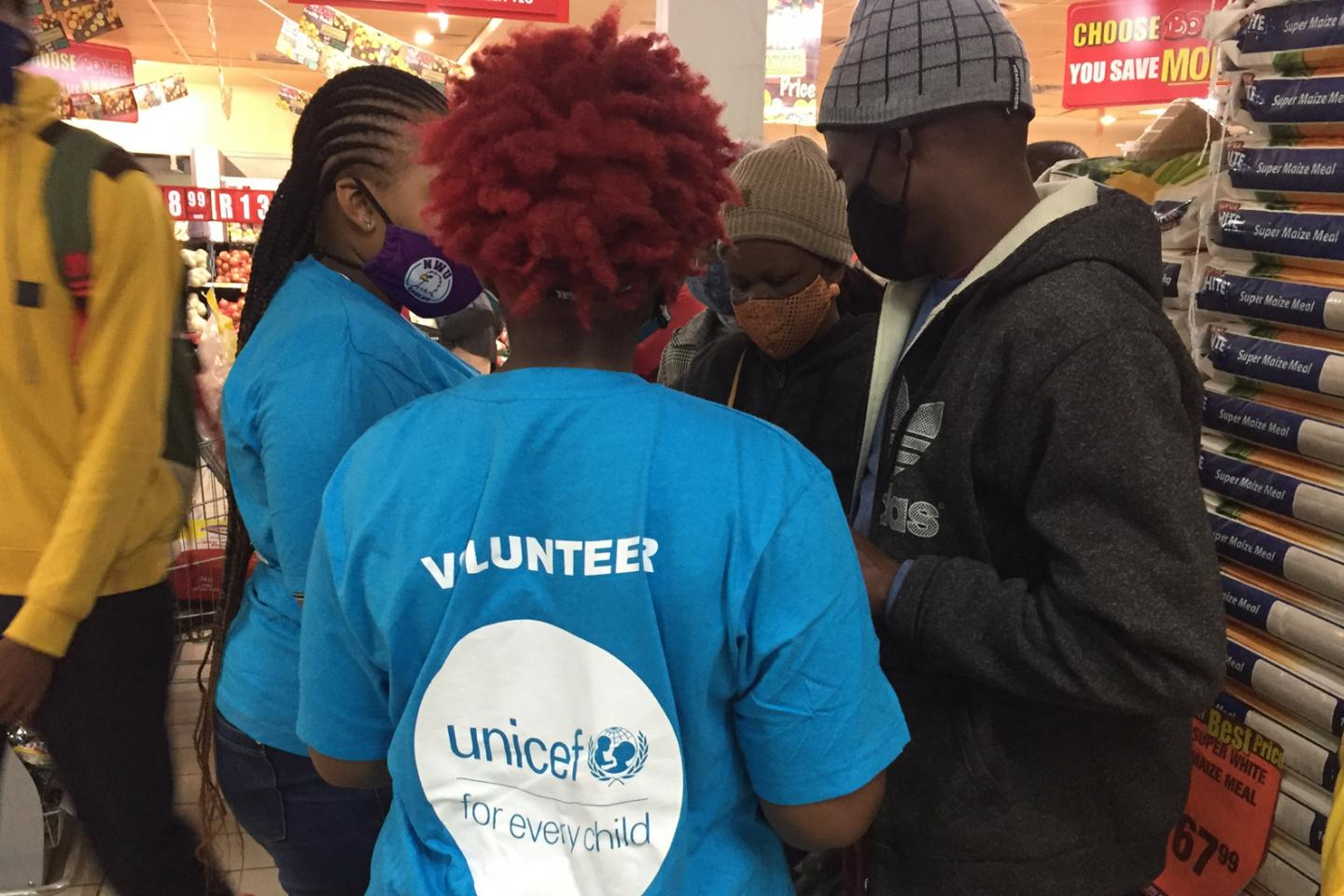 UNICEF volunteers help the elderly register for their COVID-19 vaccinations